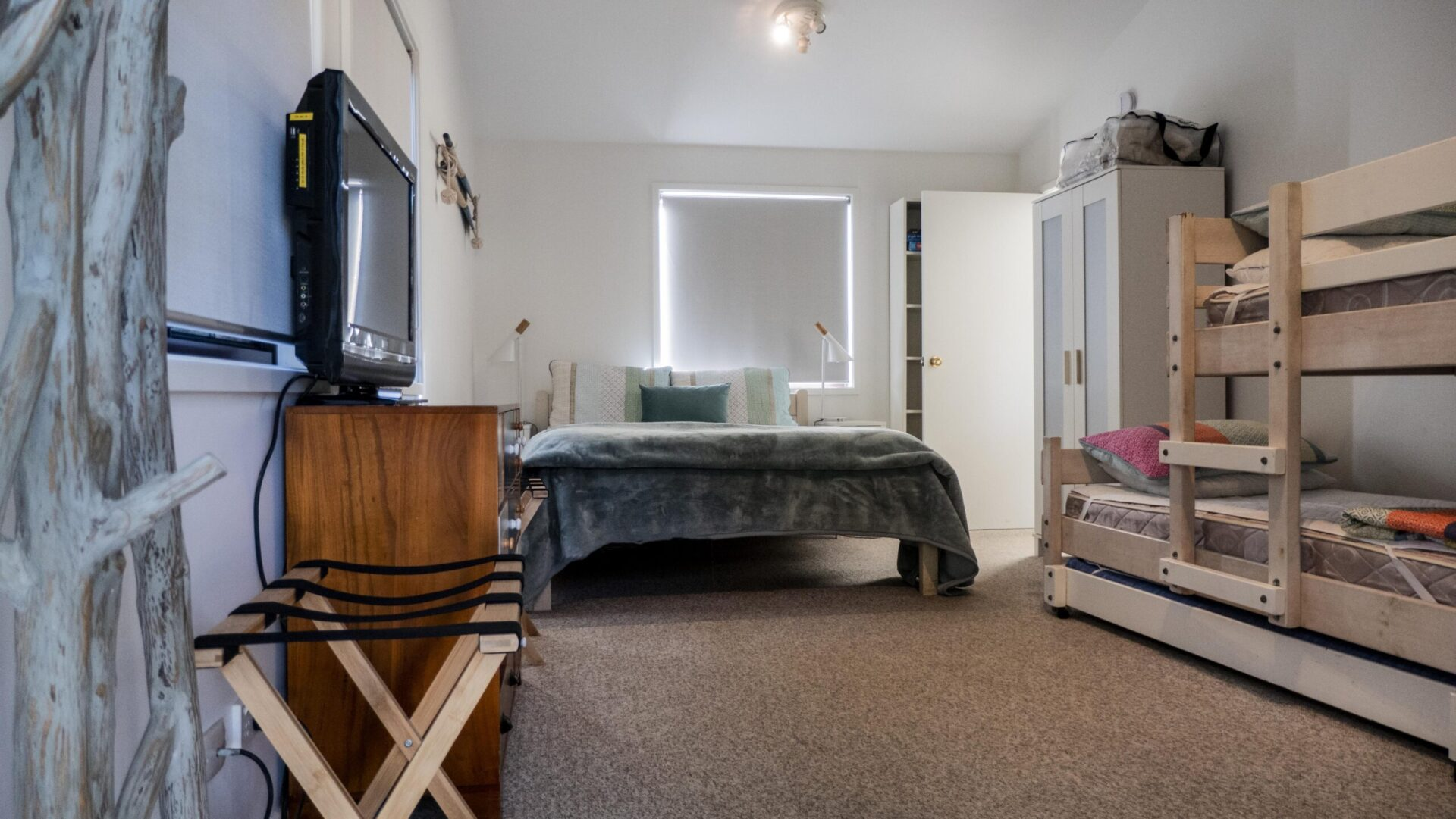 Upstairs Family Room has triple bunk beds, queen bed and personal TV. Copa Beachside.