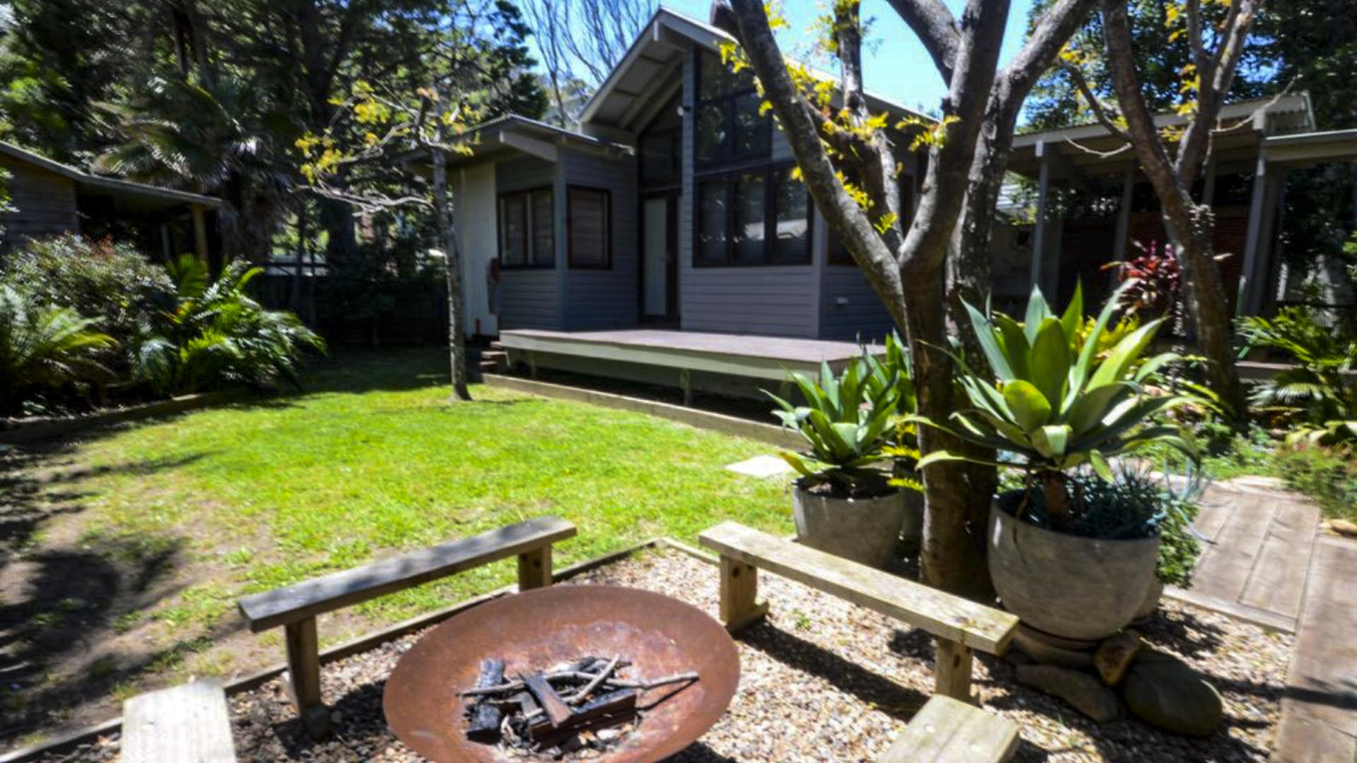 Back Yard with Annex, Lawn, Garden, Firepit and Morson's Hut. Copa Beachside.