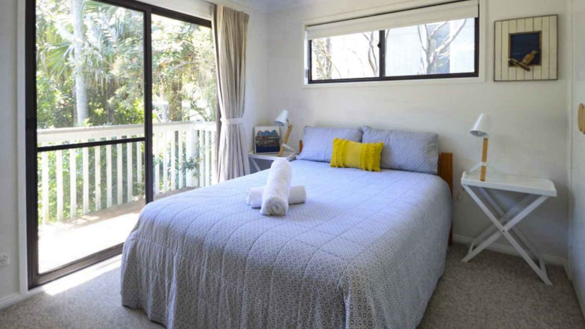 Upstairs bedroom with Queen bed opening onto a balcony. Copa Beachside.